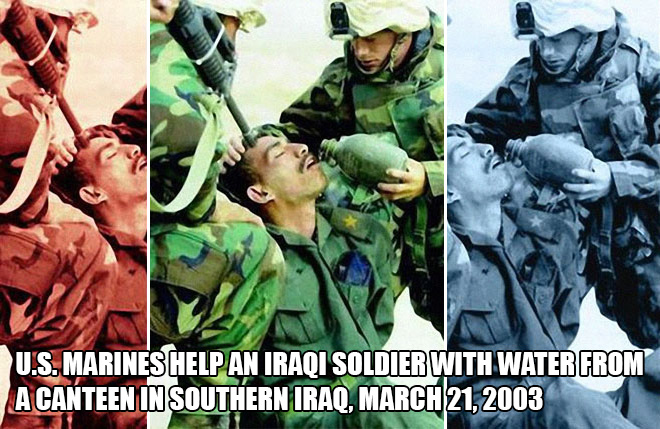 U.S. Marines help an Iraqi soldier with water from a canteen in southern Iraq, march 21, 2003