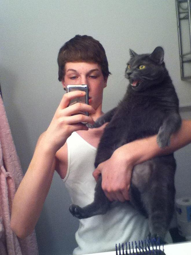 Weirdest selfie with a cat ever.
