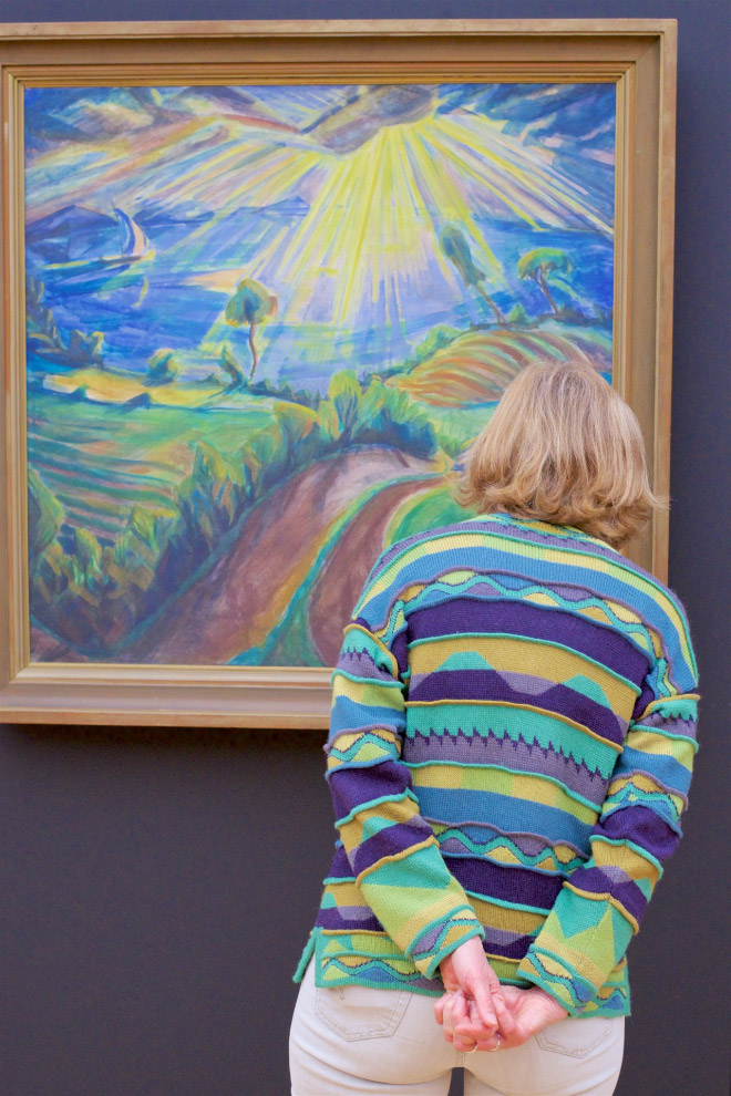 Her sweater is perfectly matching a painting. Is this just a coincidence?