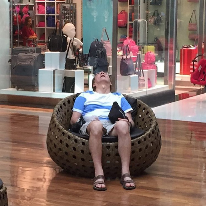 Miserable husband stuck in shopping hell.