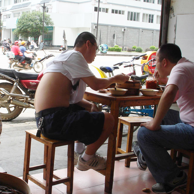 Beijing bikini guy on a lunch break.