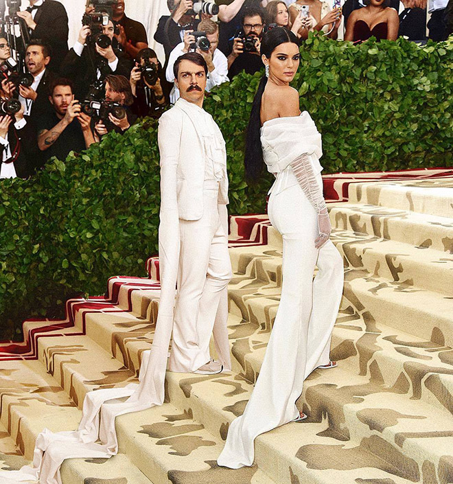 Kirby Jenner and Kendall Jenner posing on the stairs.