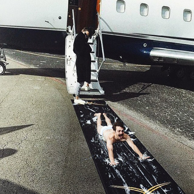 Kirby Jenner and Kendall Jenner exiting a plane.