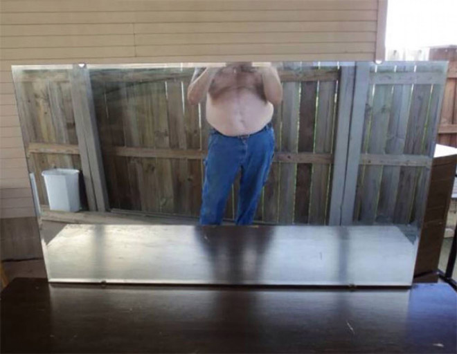 Shirtless mirror seller.