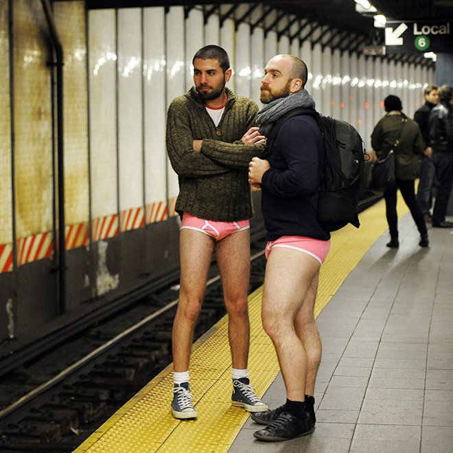 "Guys participating in ""No pants subway ride"" movement."