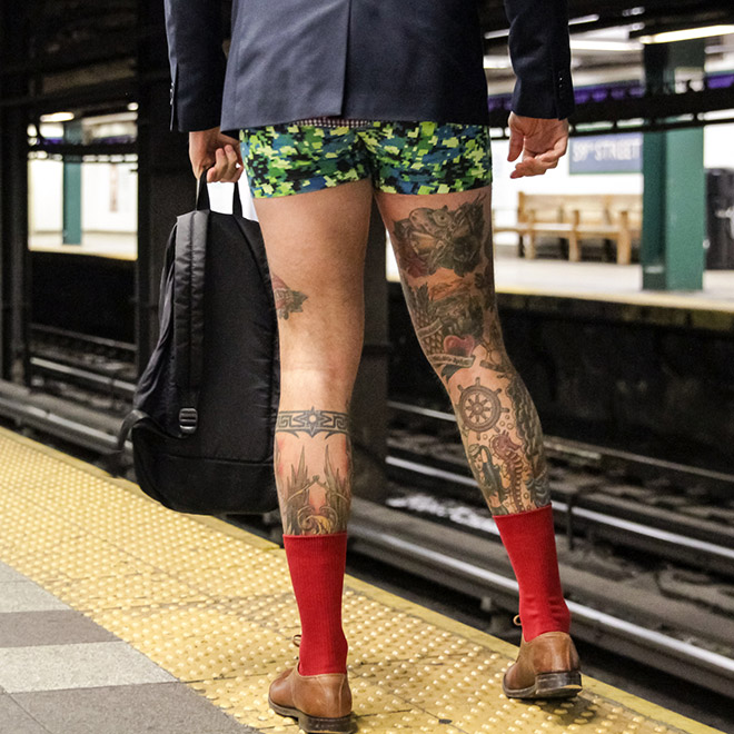 "He's participating in ""No pants subway ride"" movement."