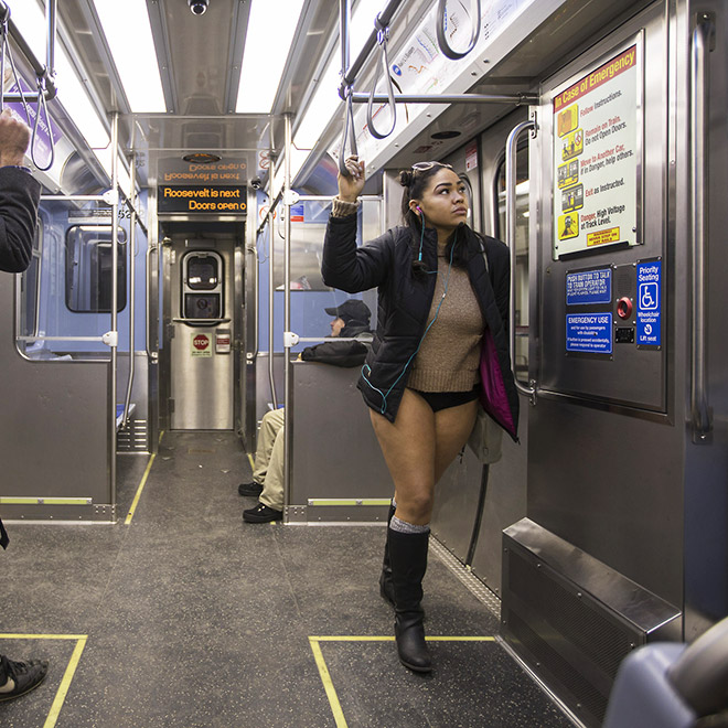 "She's participating in ""No pants subway ride"" movement."