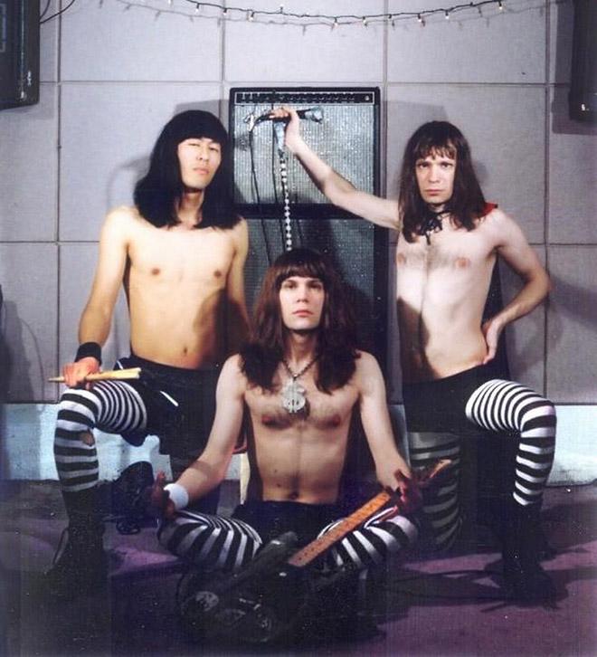 Really awkward metal band group photo.