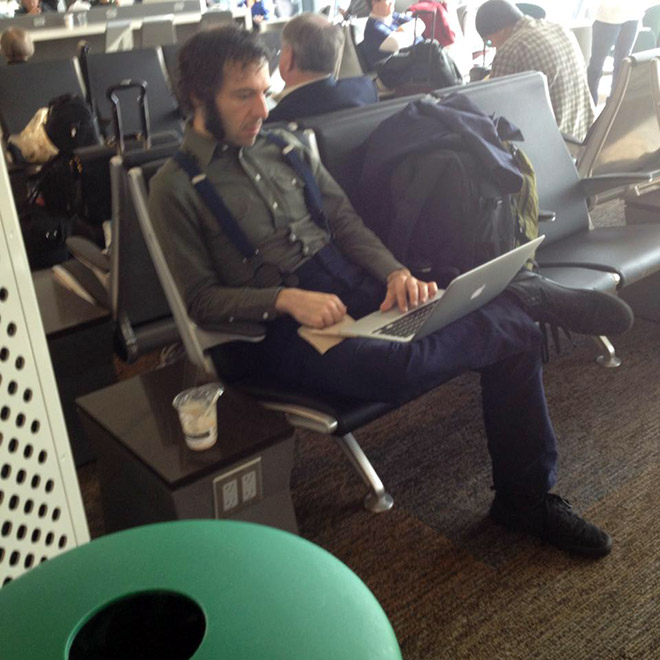Hipster writing his blog.