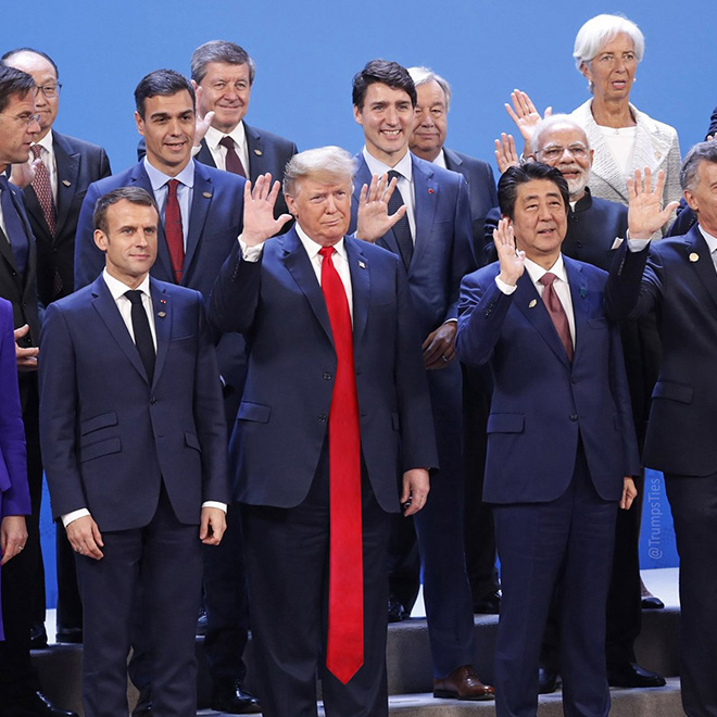 Trump posing with pals in his favorite red tie.