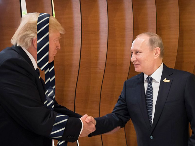 Trump greeting Putin while wearing his favorite tie.