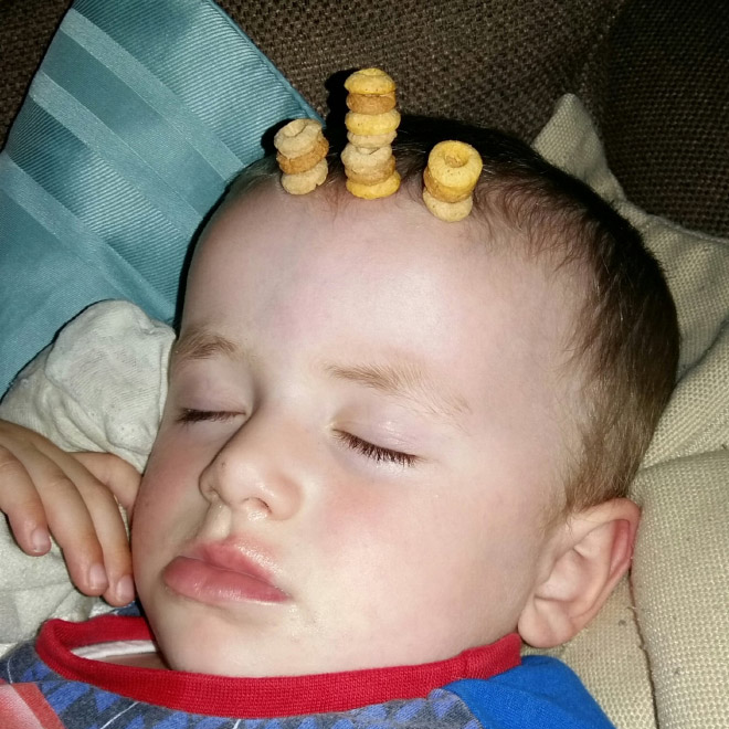 Dumb viral trend: stacking cereal on babies. #CheerioChallenge