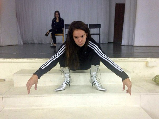 Squatting slav in a tracksuit.