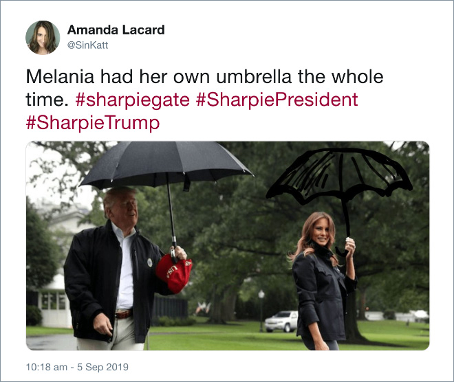 Melania had her own umbrella the whole time.