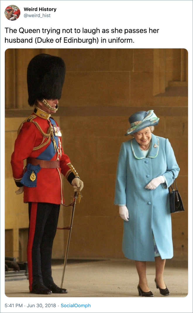 The Queen trying not to laugh as she passes her husband (Duke of Edinburgh) in uniform.