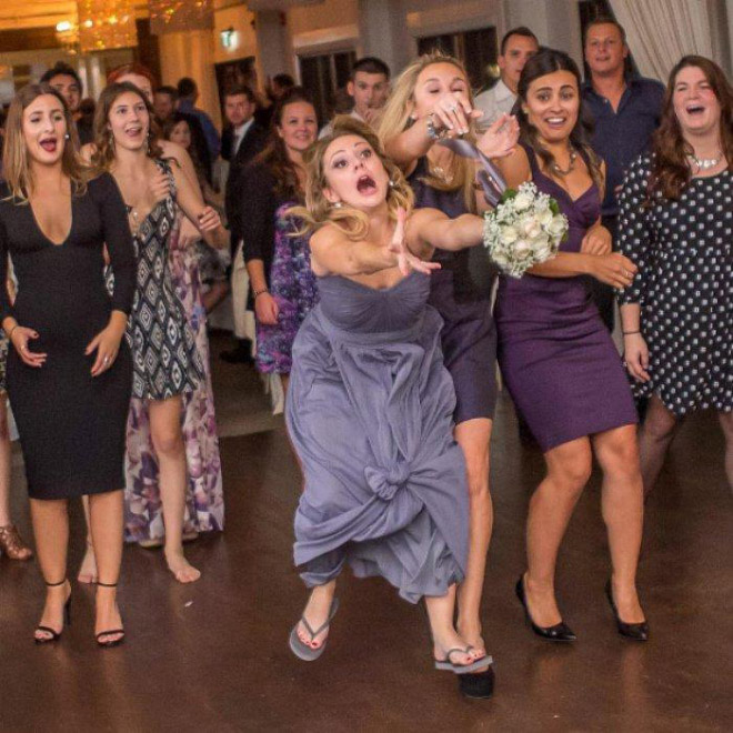 Some bridesmaids REALLY want to catch the bouquet.