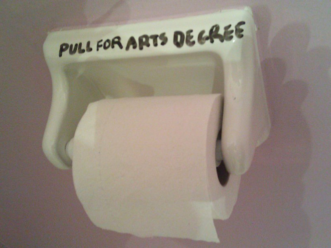 Funny toilet graffiti.