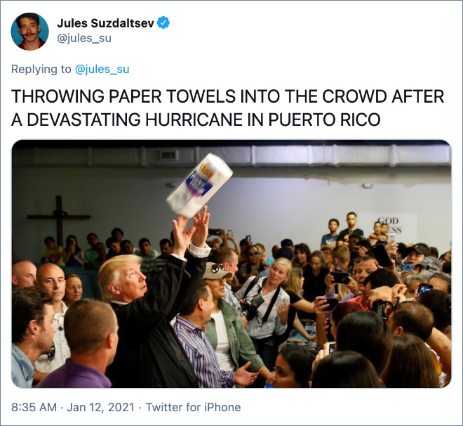 THROWING PAPER TOWELS INTO THE CROWD AFTER A DEVASTATING HURRICANE IN PUERTO RICO