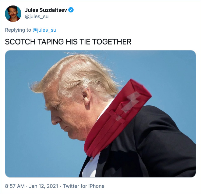 SCOTCH TAPING HIS TIE TOGETHER