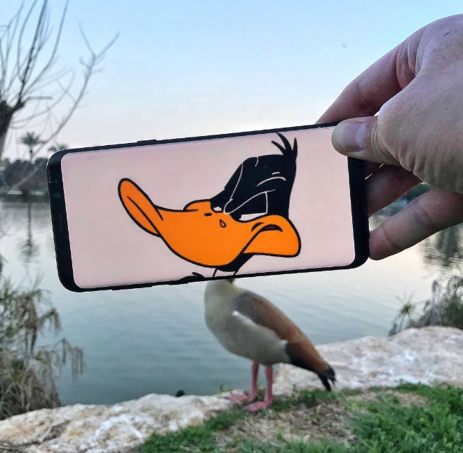 Funny photo/reality manipulation with a phone.
